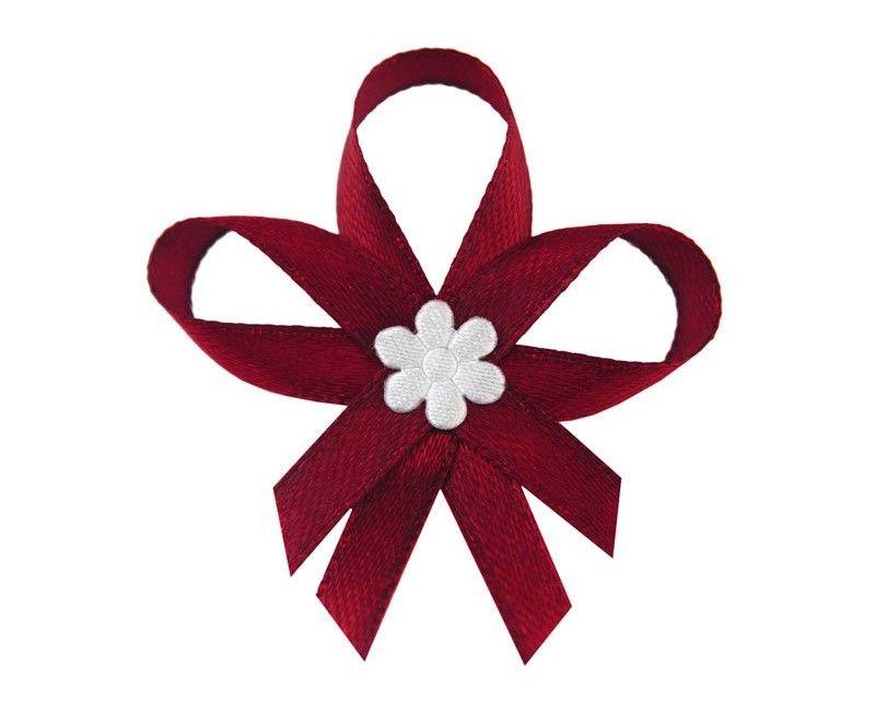 Rode lintjes met witte bloem