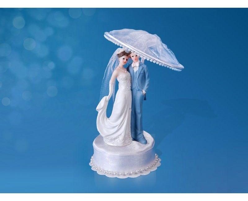 Bruidstaart topping bruidspaar met zonneparaplu en parels